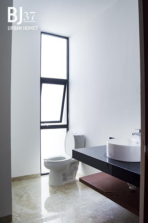 """Foto Condominio en Benito Juárez Nte Un desarrollo residencial que cuenta diez casas estilo """"Urban Homes"""" que combinan el diseño, acabados de primera, privacidad y seguridad, logrando un balance perfecto entre lujo y armonía. número 19"""
