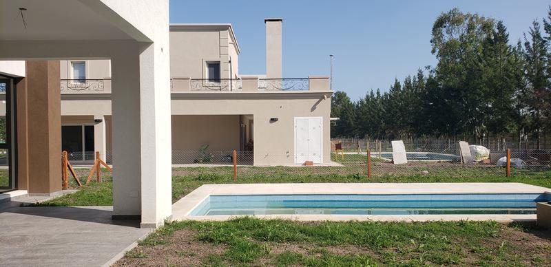 Foto Casa en Venta en  Terralagos,  Countries/B.Cerrado (Ezeiza)  Oportunidad! Moderna casa a estrenar en Terralagos!