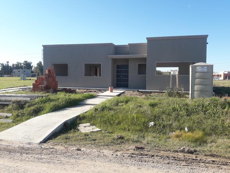 Foto Casa en Venta en  La Pista,  Ingeniero Maschwitz  Casa a estrenar 4 amb en Barrio El Ensueño, Ing. Maschwitz(Entrega Julio 2019)