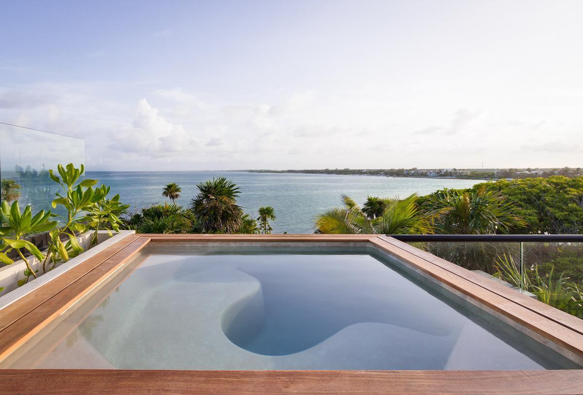 Foto Departamento en Renta temporal en  Bahías de Punta Solimán,  Tulum  Maravillosa Penthouse frente mar, con playa privada, terraza privada