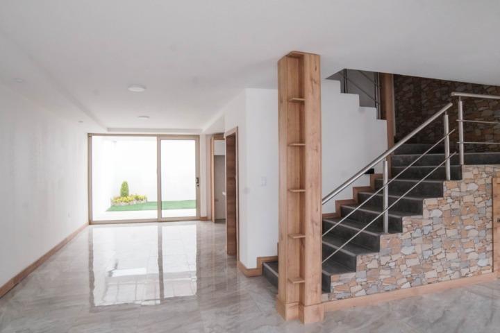 Foto Casa en Venta en  Sur de Cuenca,  Cuenca  Hermosa villa en venta por estrenar sector 1ro. De Mayo $158.000dlrs.