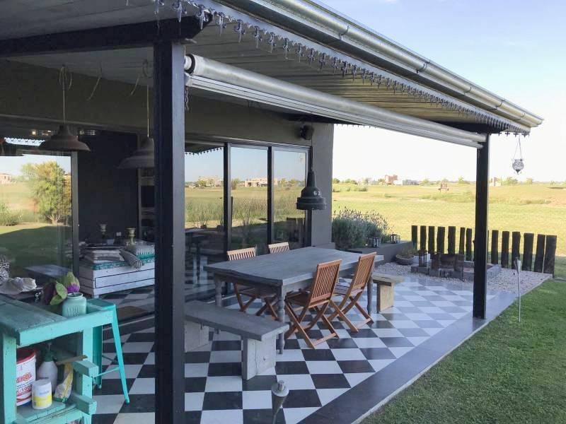 Foto Casa en Venta en  El Canton,  Countries/B.Cerrado  Barrio Golf al 400