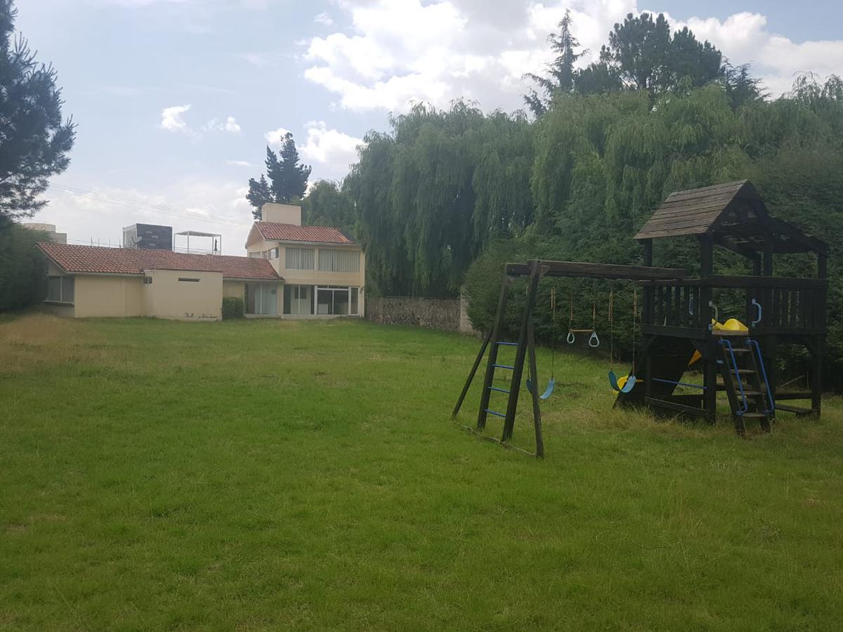 Foto Casa en Venta en  Cacalomacan,  Toluca  VENTA DE CASA CON TERRENO EXCEDENTE EN CACALOMACAN TOLUCA