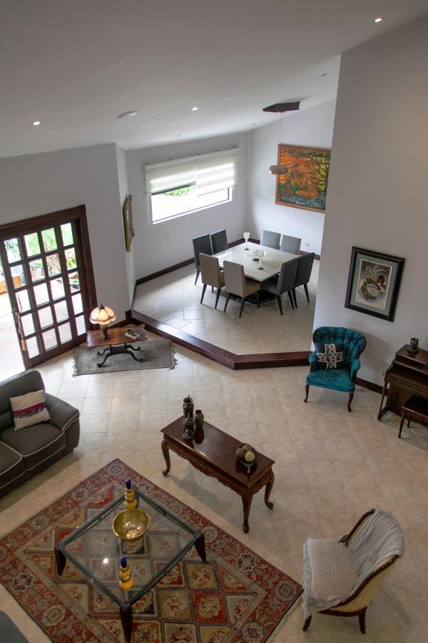 Foto Casa en condominio en Venta | Renta en  Santana,  Santa Ana  Lindora/  1 planta/ Jardín/ Ubicación/ Alquiler con opción de compra/ Exclusividad
