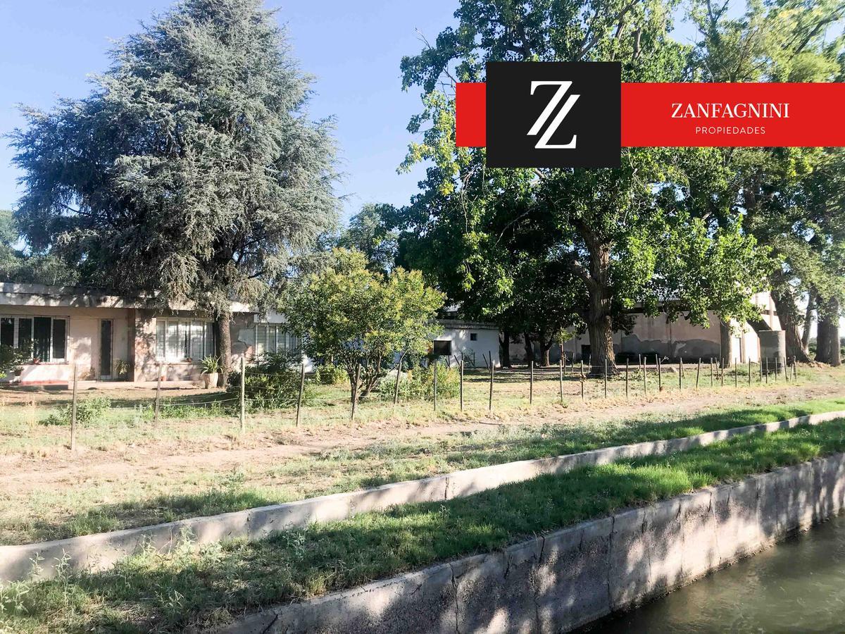 Foto Terreno en Venta en  San Martin ,  Mendoza  Finca en Carril Costa Canal Montecaseros