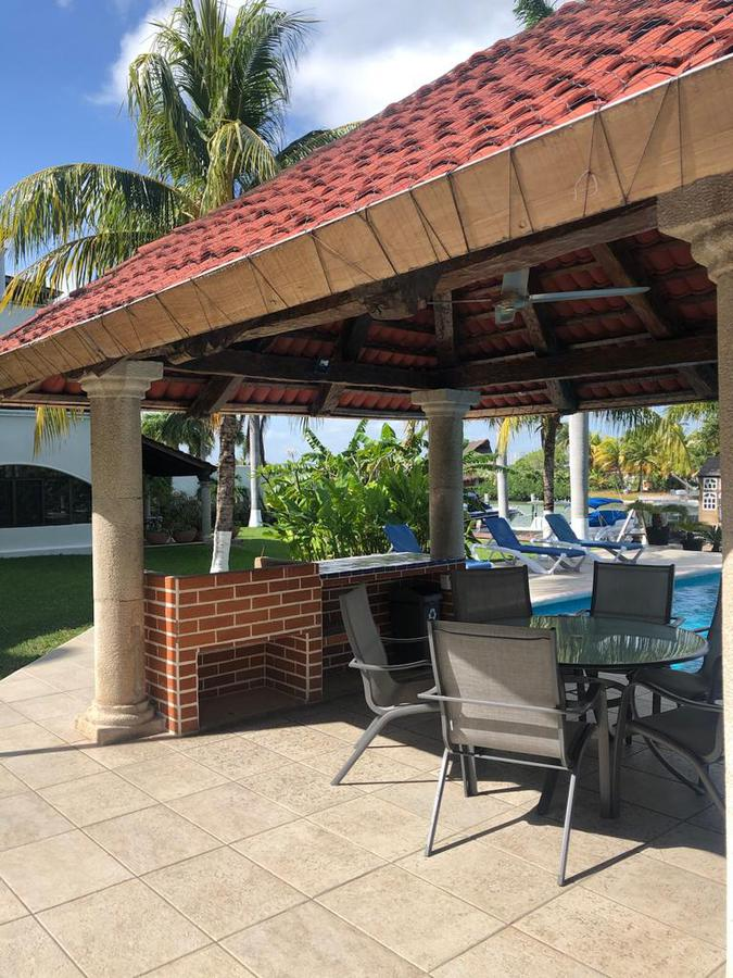 Foto Casa en condominio en Renta en  Zona Hotelera,  Cancún  Casa en RENTA con vista a la laguna TOTALMENTE AMUEBLADA