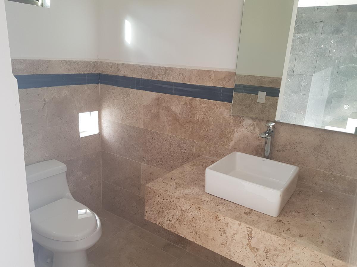 Foto Casa en Venta en  Benito Juárez ,  Quintana Roo  CASA VENTA  DE OPORTUNIDAD EN AQUA RESIDENCIAL  CANCUN