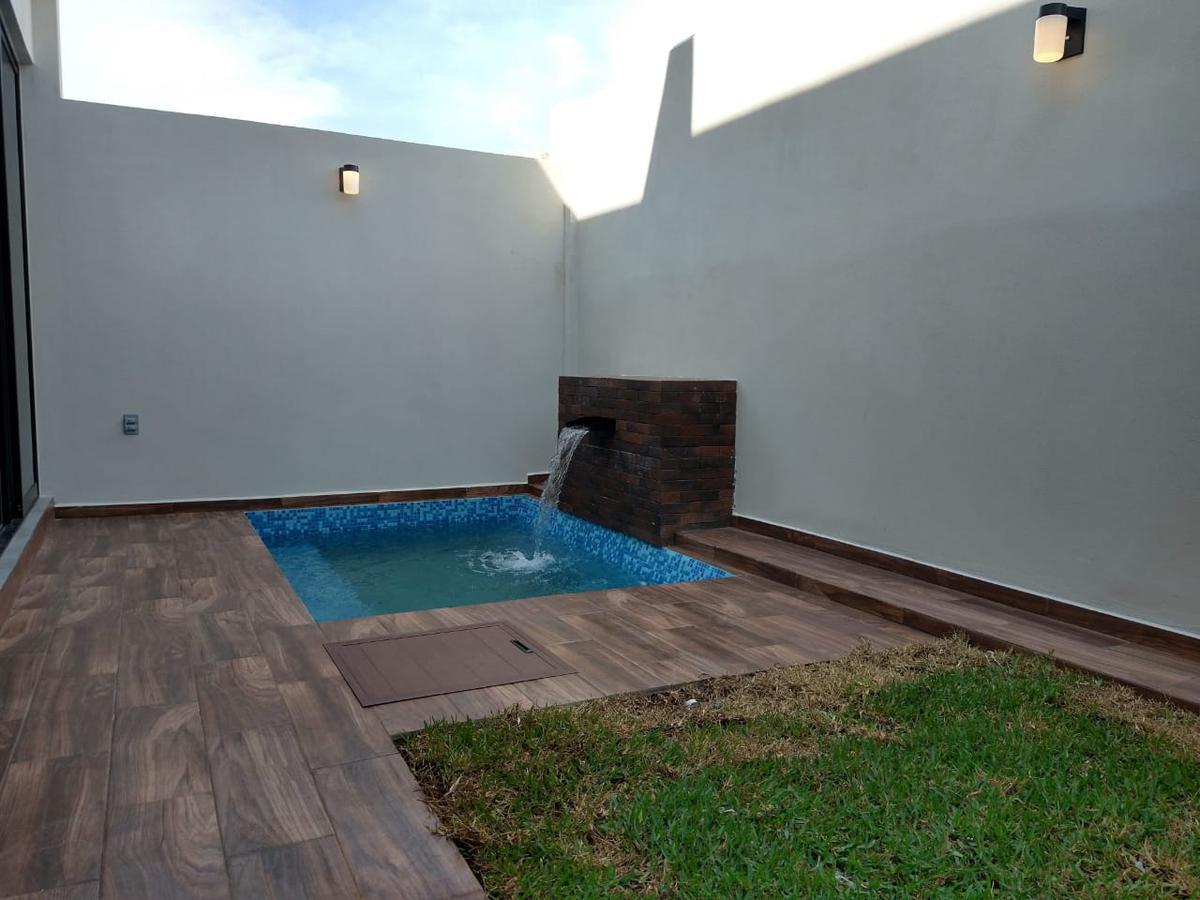 Foto Casa en Venta en  Fraccionamiento Lomas de la Rioja,  Alvarado  Lomas de la Rioja con Alberca y Roof Garden