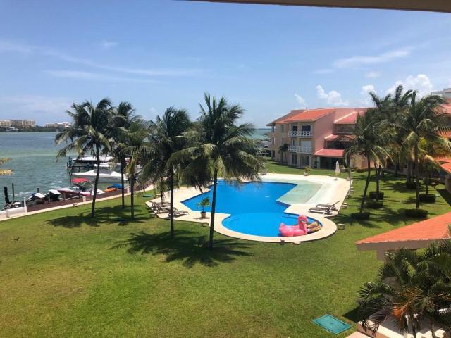 Foto Departamento en Renta en  Isla Dorada,  Cancún  Isla Dorada. Isla Real. Bonito Departamento Amueblado en Renta de 2 Recámaras con Muelle y Super Vista a la Laguna. .  Zona Hotelera, Cancún, Quintana Roo