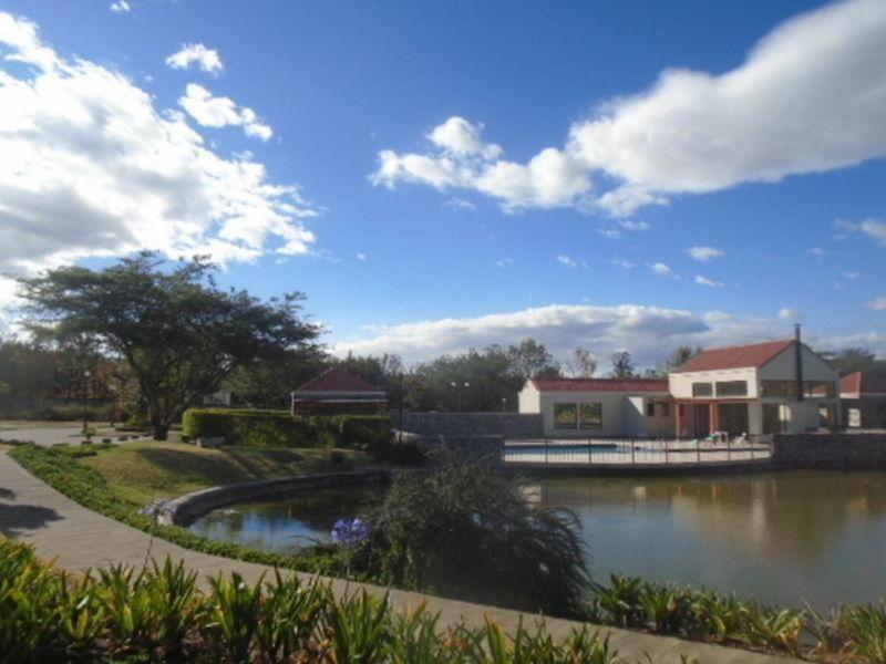Foto Terreno en Venta en  Puembo,  Quito  Puembo, Urbanización Privada, piscina, área verdes, terreno plano