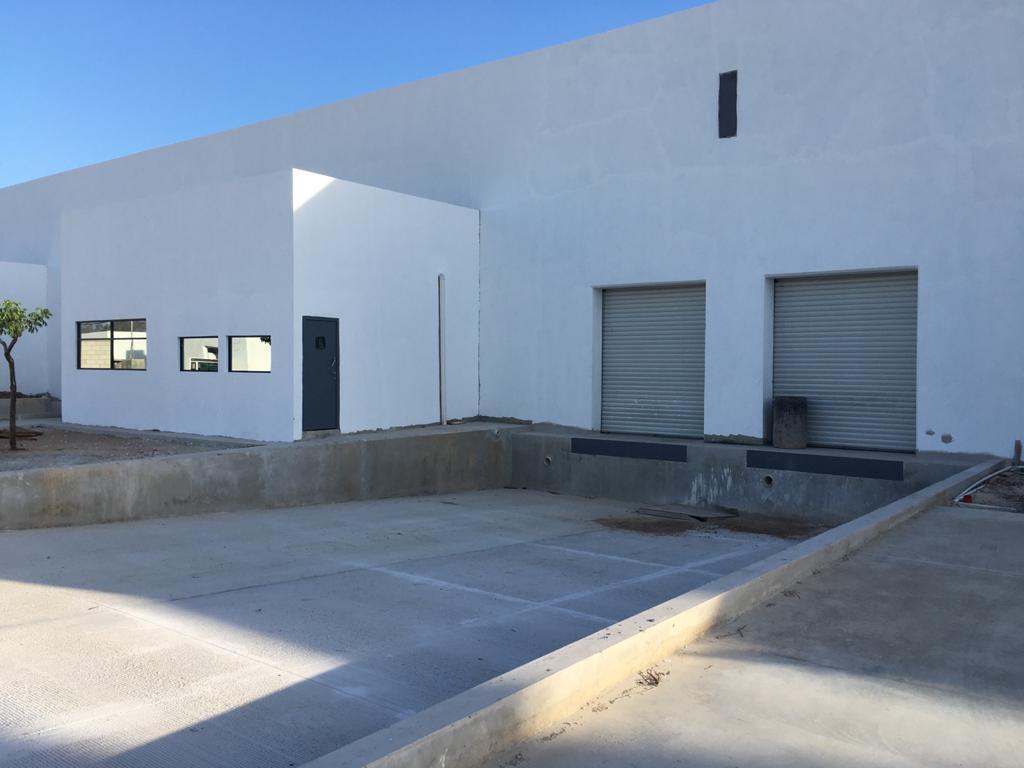 Foto Bodega Industrial en Renta en  Pueblo Tixcacal Opichen,  Mérida  Bodega Industrial de 1500m² con 4 andenes de descarga propios, 63 m² de oficinas, 2 baños, acceso por el Periférico Poniente