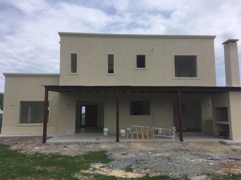 Foto Casa en Venta en  El Canton - Golf,  Countries/B.Cerrado (Escobar)  Lote al 200