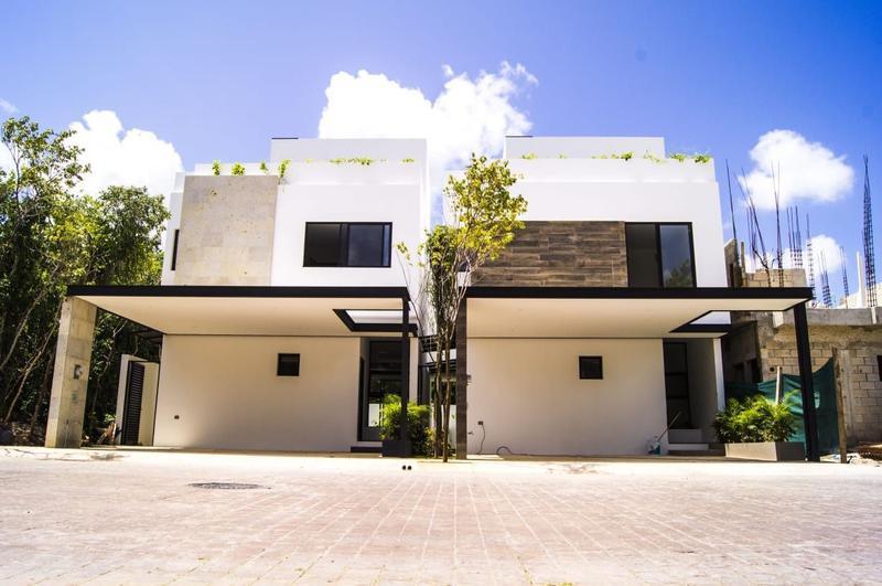 Foto Casa en condominio en Venta en  Supermanzana 320,  Cancún  CASAS EN VENTA EN CANCUN RESIDENCIAL AQUA