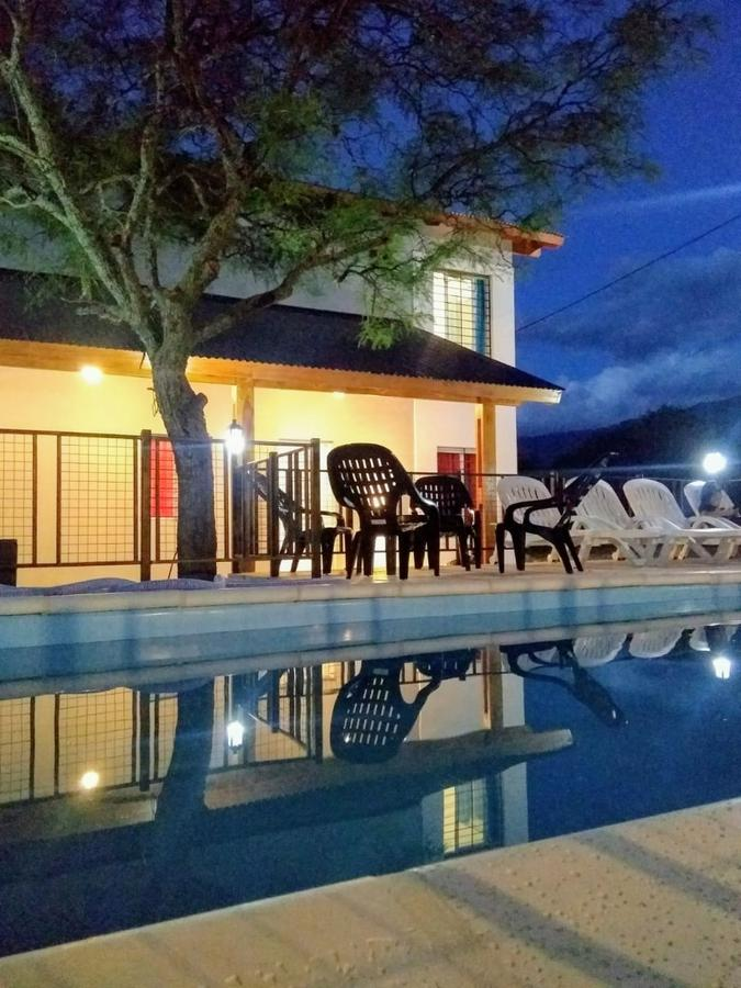 Foto Casa en Venta en  Los Molles,  Junin  VENDO COMPLEJO DE 4 CABAÑAS SOBRE UN LOTE DE 600M2 EN LOS MOLLES SAN LUIS