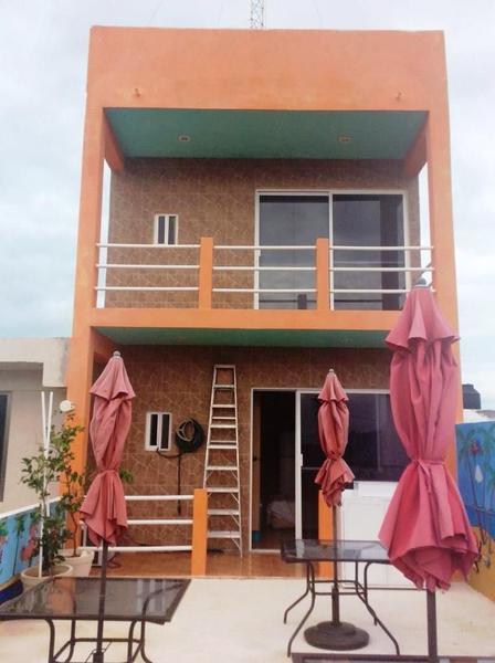 Foto Casa en Venta en  Pueblo Chelem,  Progreso  CASA EL NARANJO FRENTE AL MAR EN CHELEM