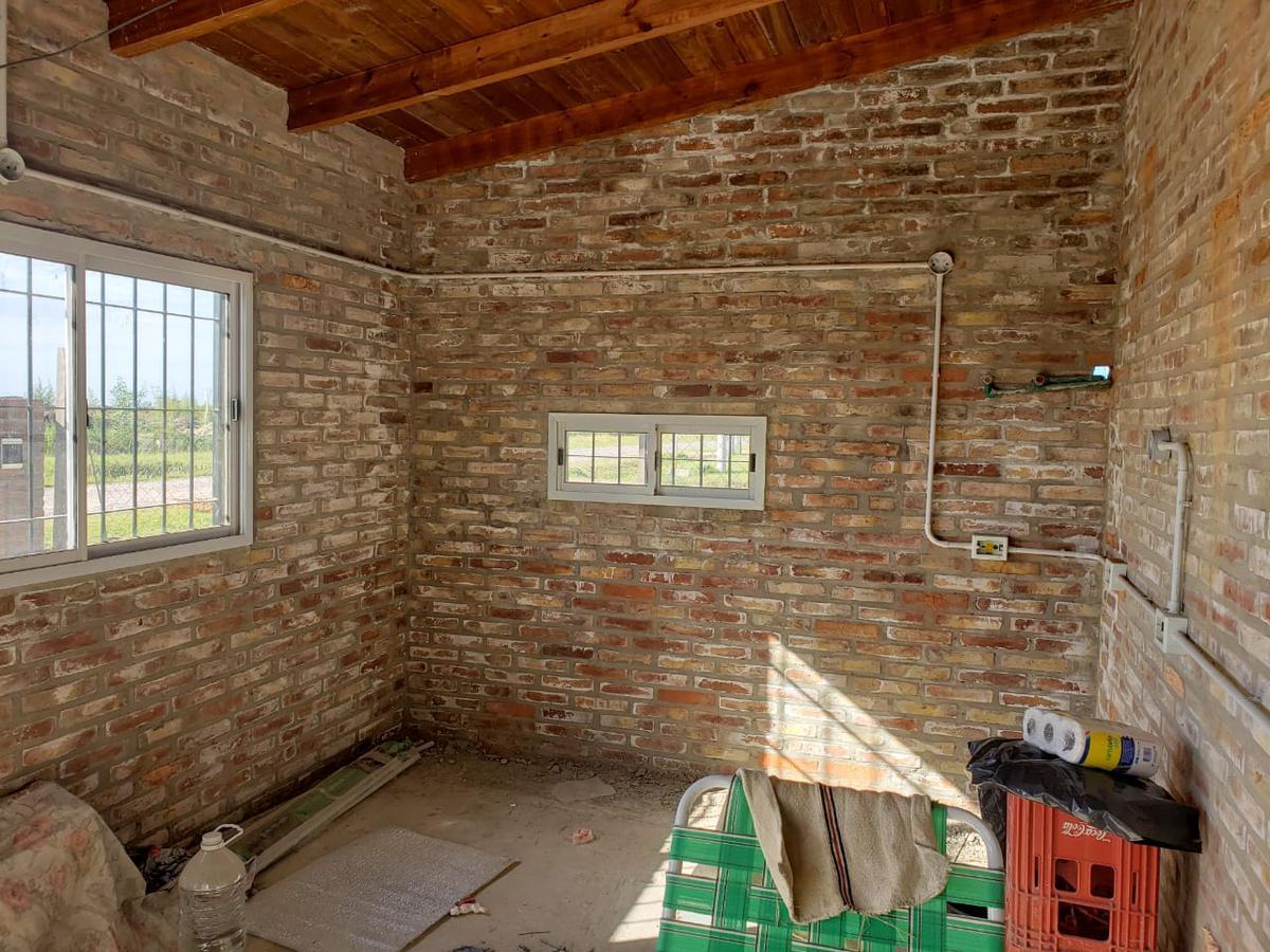 Foto Casa en Venta en  Tierra de sueños 3,  Roldan  SAN SEBASTIAN SUR 3184
