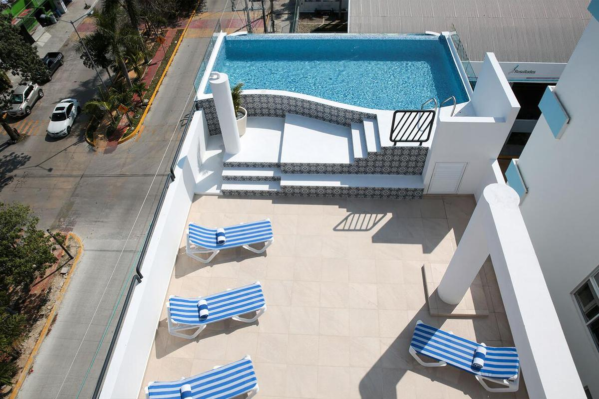 Picture Bussiness Premises in Sale in  Solidaridad ,  Quintana Roo  Hotel en venta en Playa del Carmen
