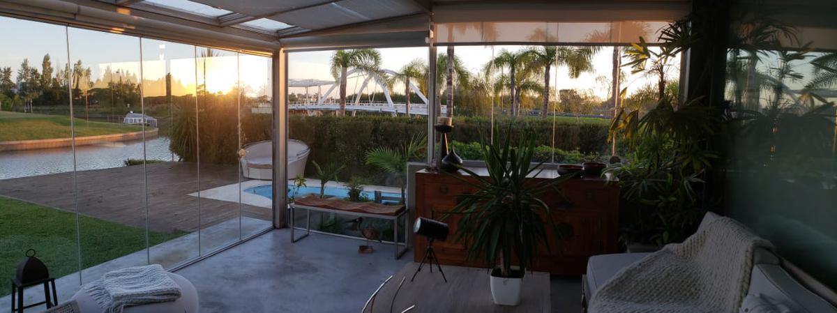 Foto Casa en Venta en  Marinas del Yacht,  El Yacht   Unico departamento en Marinas del Yacht en Planta Baja con pileta Propia, dos cocheras y amarra