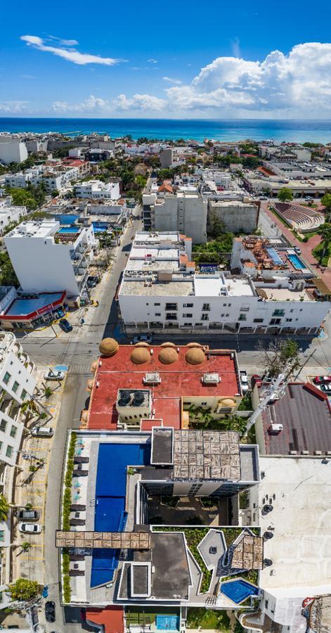 Foto Departamento en Venta en  Playa del Carmen Centro,  Solidaridad  DEPARTAMENTO A 2 CALLES DE LA PLAYA CON ALBERCA Y ROOF