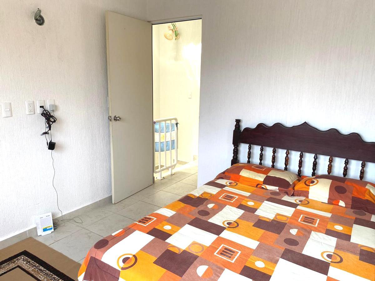 Foto Casa en Venta en  Los Olivos,  Solidaridad  CASA EN PRIVADA CON SEGURIDAD Y ALBERCA