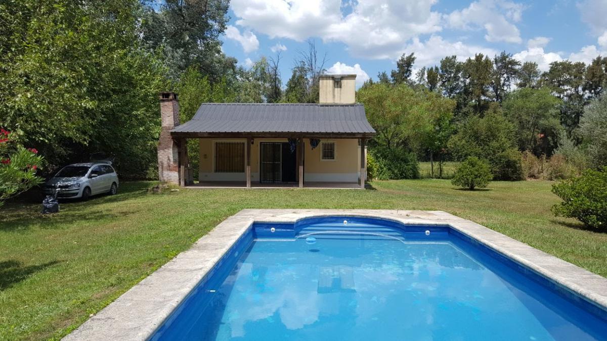 Foto Casa en Venta en  Parque Natura,  Los Cardales  Quincho con pileta en Parque Natura