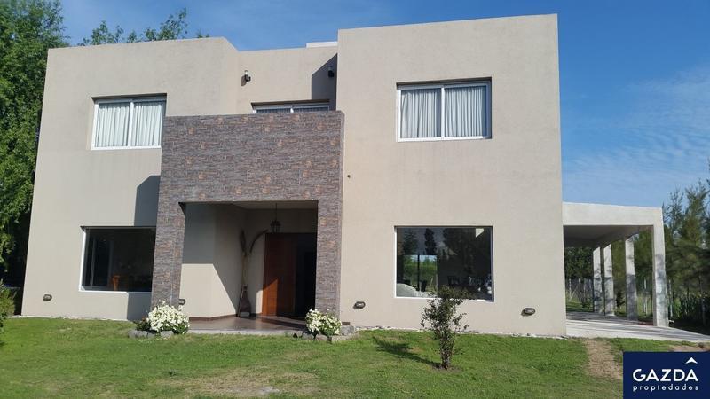 Foto Casa en Alquiler en  Brickland,  Countries/B.Cerrado  Martin Fierro 4500