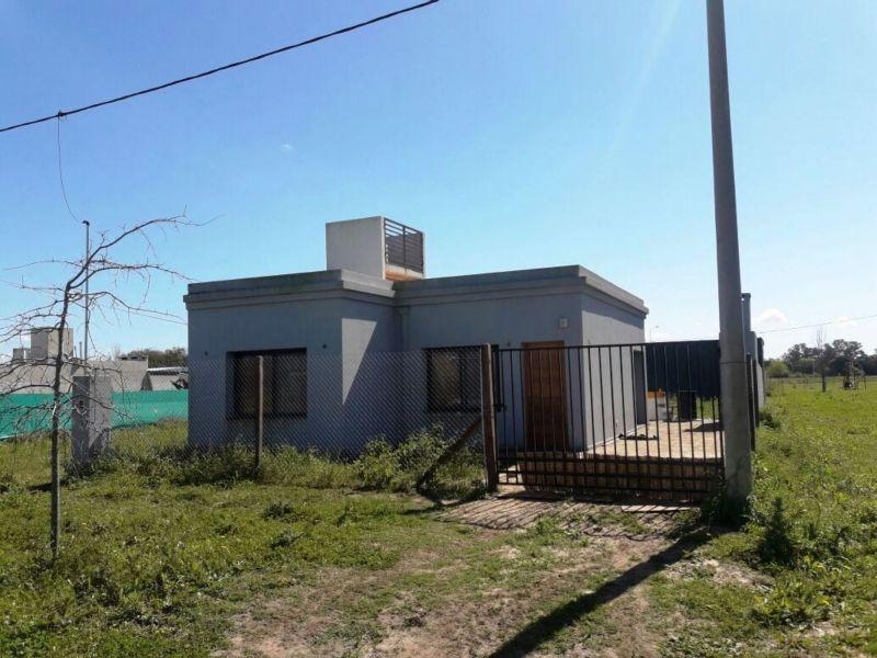 Foto Casa en Venta en  Alvarez,  Rosario  Ruta 18 km 12.5 Alvarez