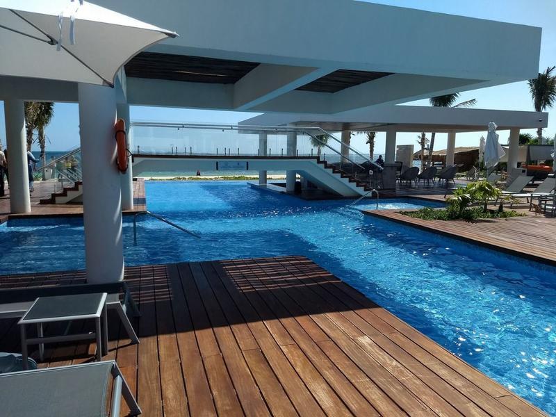 Foto Departamento en Venta en  Isla Blanca,  Isla Mujeres  Venta Departamento Cancun con playa, marina, alberca, gimnasio, 2 Rec