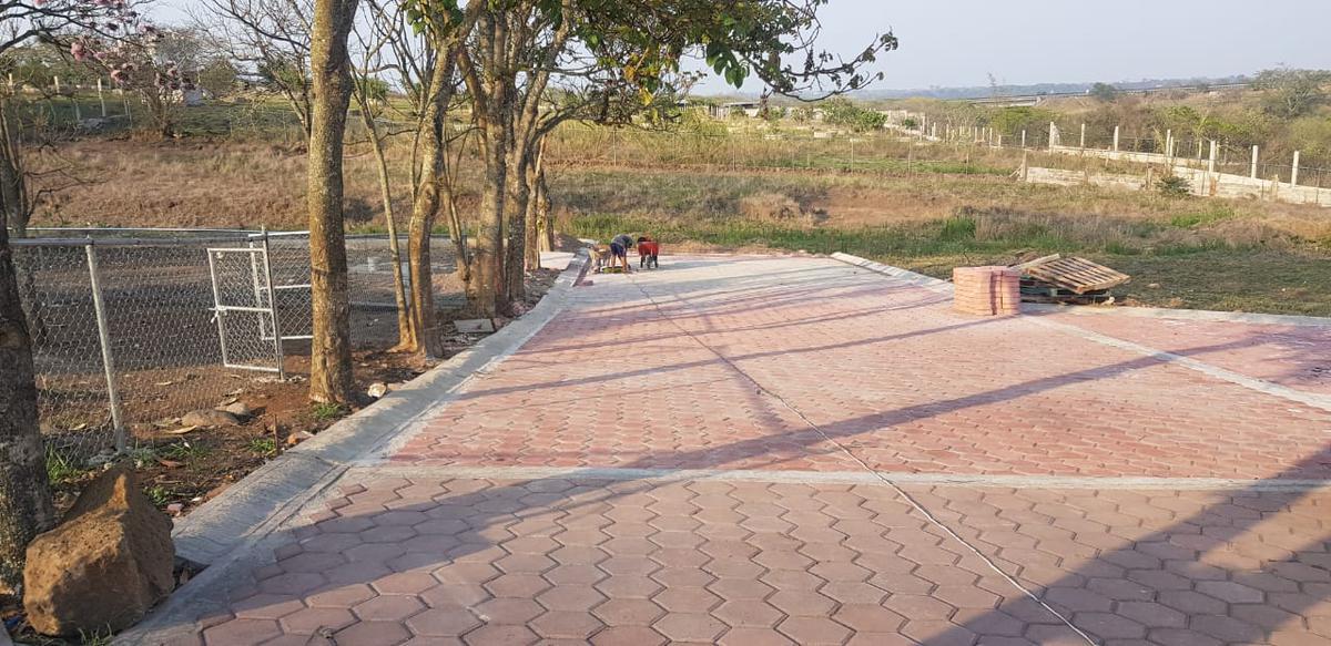 Foto Terreno en Venta |  en  Pueblo Dos Ríos,  Emiliano Zapata  Terreno en venta en Emiliano Zapata, L14 MB, Fracc. Cañada de Dos Ríos, junto a área verde