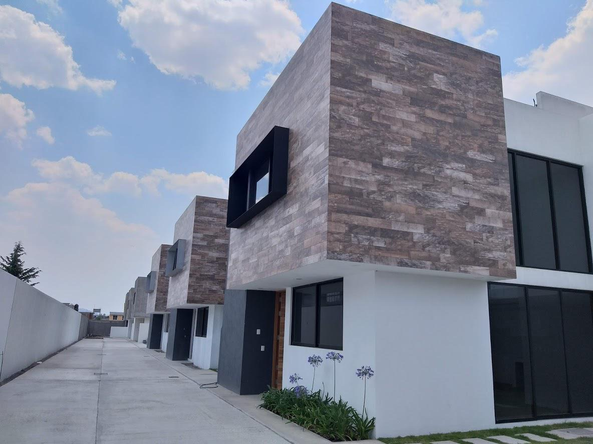 Foto Casa en condominio en Venta en  Santa María Totoltepec,  Toluca  VENTA DE CASA NUEVA EN PRIVADA TOLUCA MEXICO