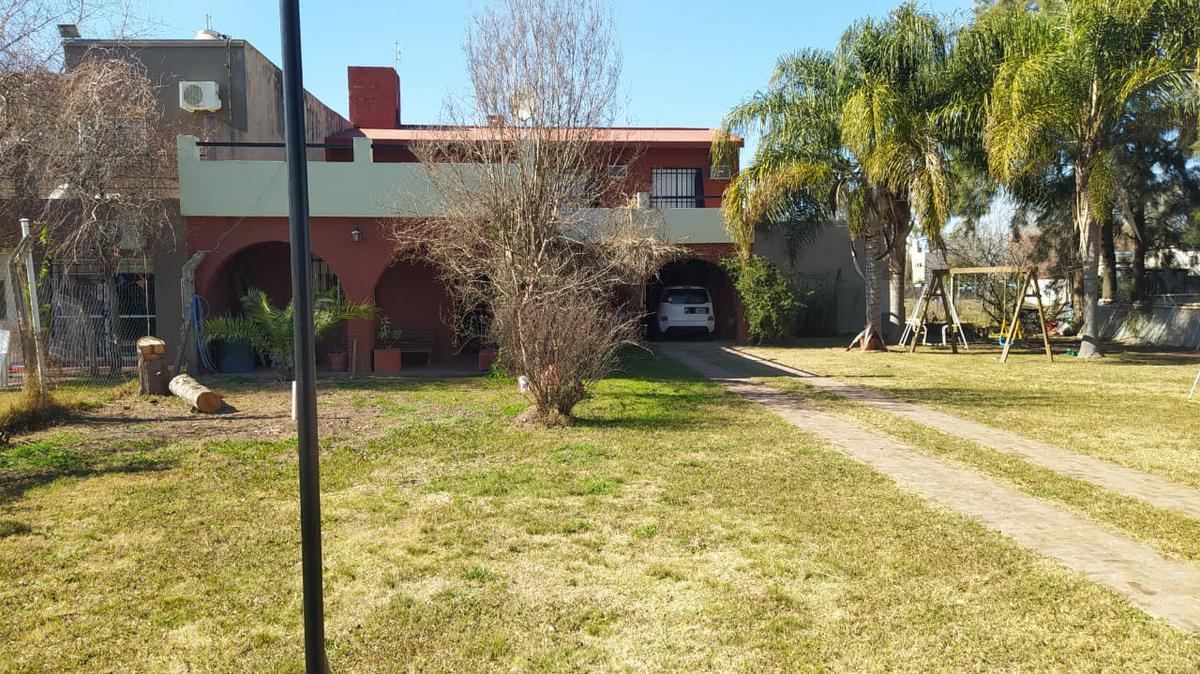 Foto Casa en Venta en  Funes ,  Santa Fe  Iguazu al 2500