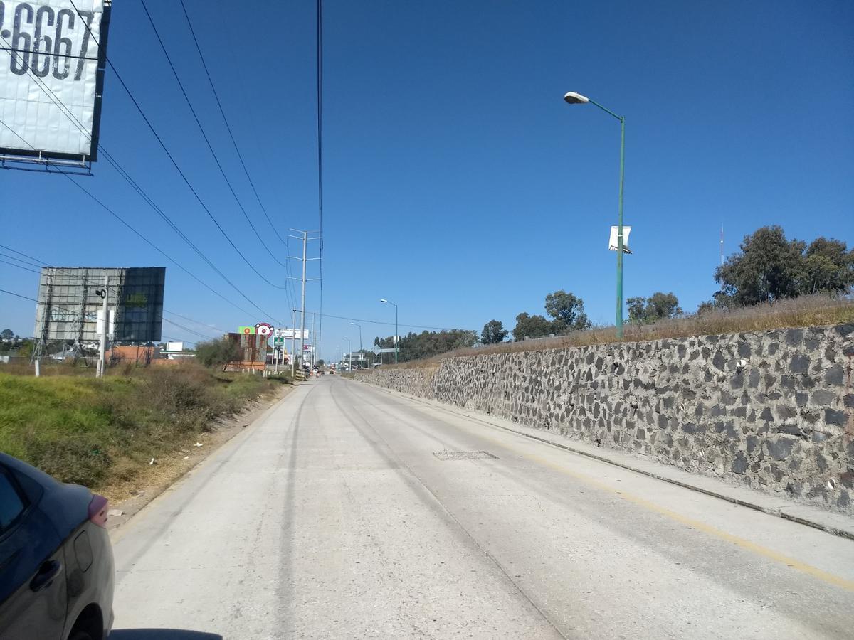 Foto Terreno en Venta en  Pueblo San Francisco Ocotlán,  Coronango  Venta de terreno comercial sobre Autopista México Puebla