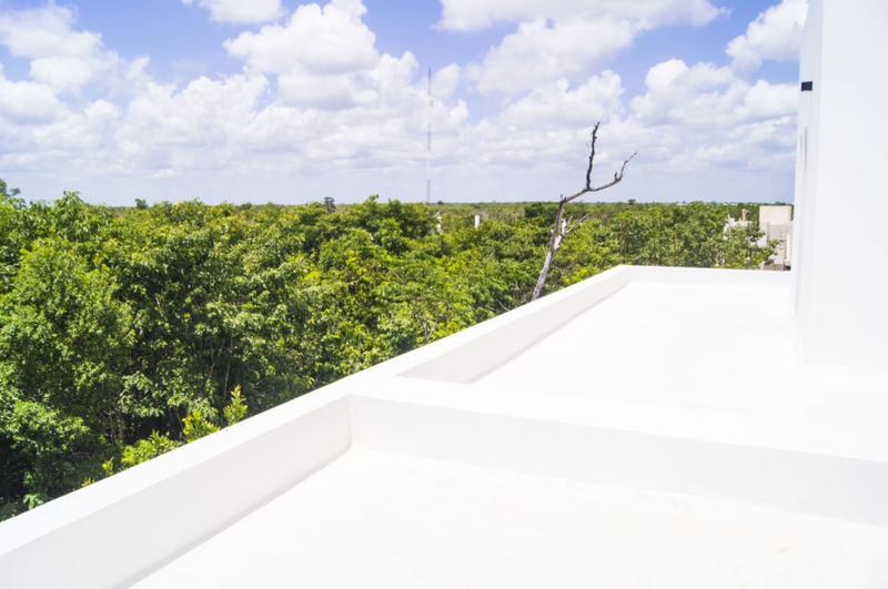 Foto Casa en condominio en Venta en  Cancún Centro,  Cancún  CASA NUEVA MINIMALISTA EN AQUA BY CUMBRES
