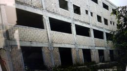 Foto Edificio Comercial en Venta en  Alfredo V Bonfil,  Cancún  TERRENO CON BODEGAS Y LOCALES EN VENTA/RENTA EN CANCUN EN AVENIDA COLOSIO