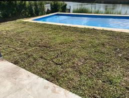 Foto Casa en Venta en  El Canton,  Countries/B.Cerrado (Escobar)  Venta de casa en una planta a la laguna en el barrio El Cantón, Puerto, Escobar
