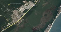 Foto Terreno en Venta en  Puerto Morelos,  Cancún  OPORTUNIDAD LOTE PARA INVERSIÓN EN PUERTO MORELOS USO H2 C2455