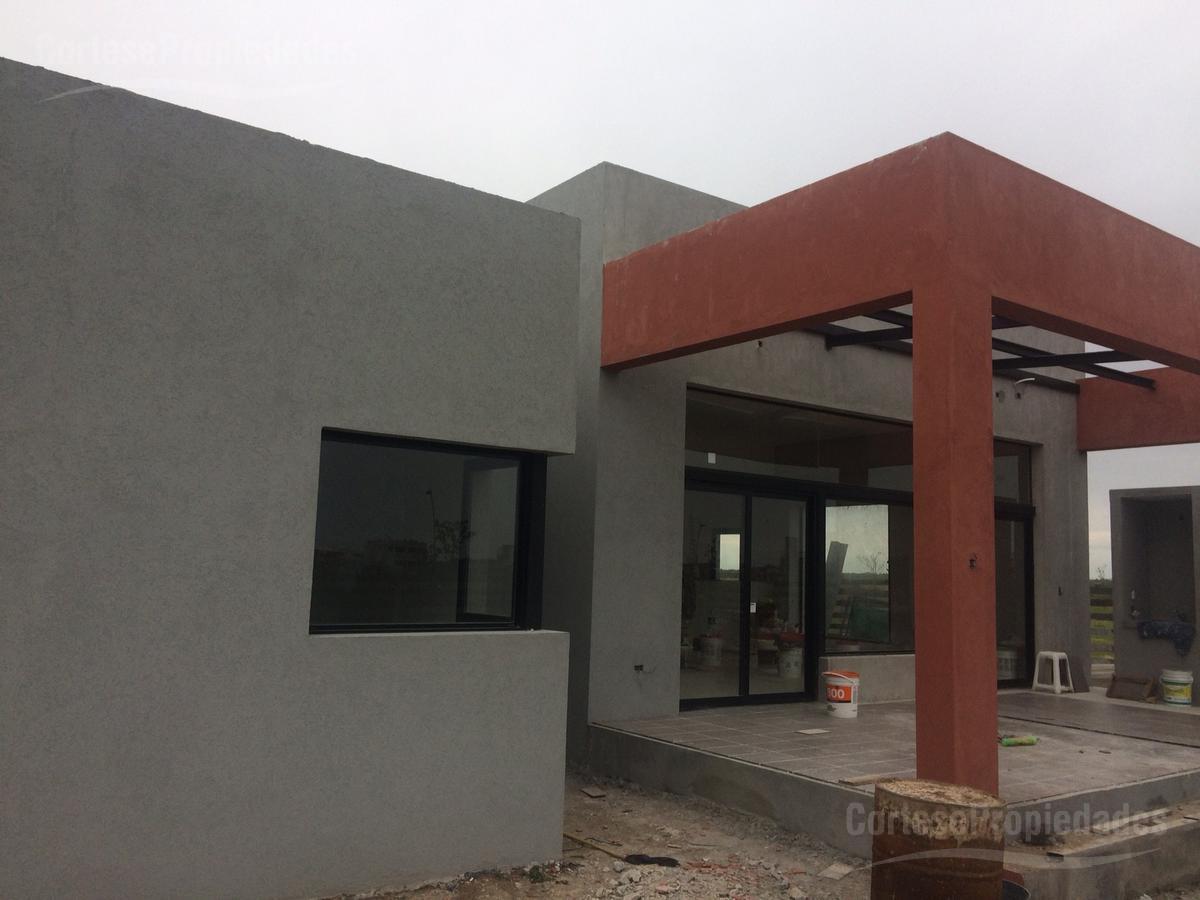 Foto Casa en Alquiler en  Ceibos,  Puertos del Lago  Barrio Ceibos