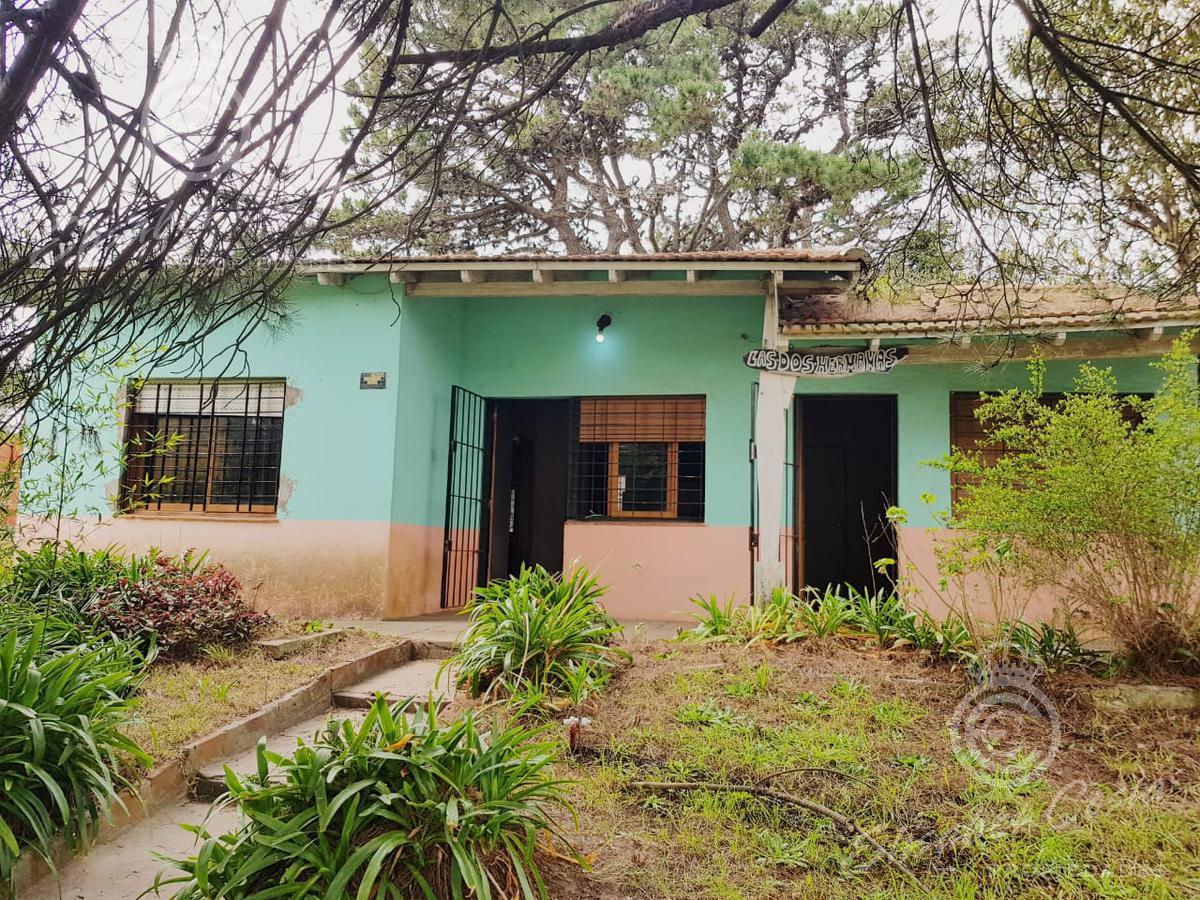 Foto Casa en Venta en  Villa Gesell ,  Costa Atlantica  Paseo 123 numero 1048
