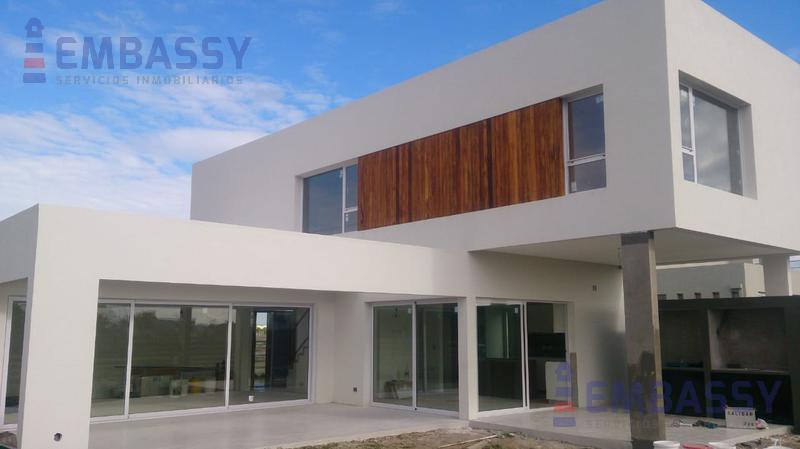Foto Casa en Venta en  Vistas,  Puertos del Lago   Importante y moderna Casa a Estrenar en Puertos del Lago