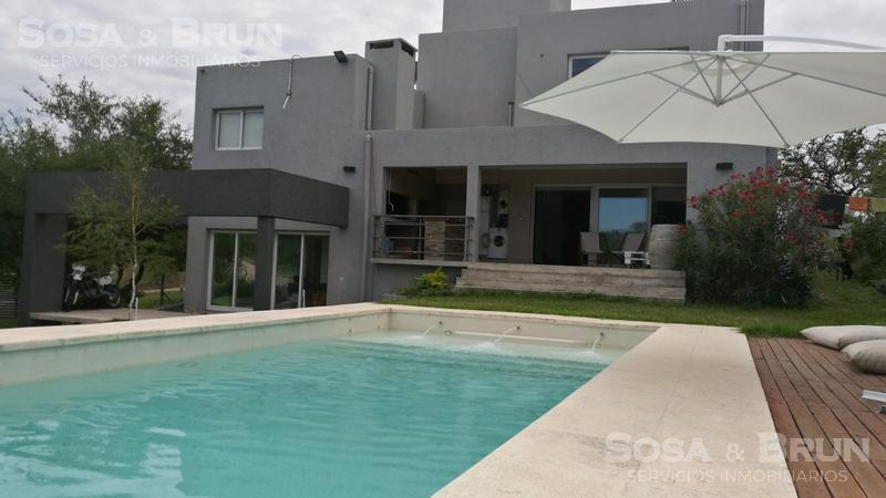 Foto Casa en Venta en  Rio Ceballos ,  Cordoba  Mendiolaza vendo Casa 3 dormitorios Molinos de viento
