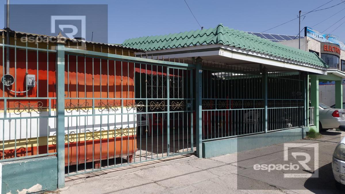 Foto Casa en Venta en  Fidel VelAzquez,  Chihuahua  CASA EN VENTA DE UNA PLANTA SOBRE AV. AMÉRICAS IDEAL PARA NEGOCIO