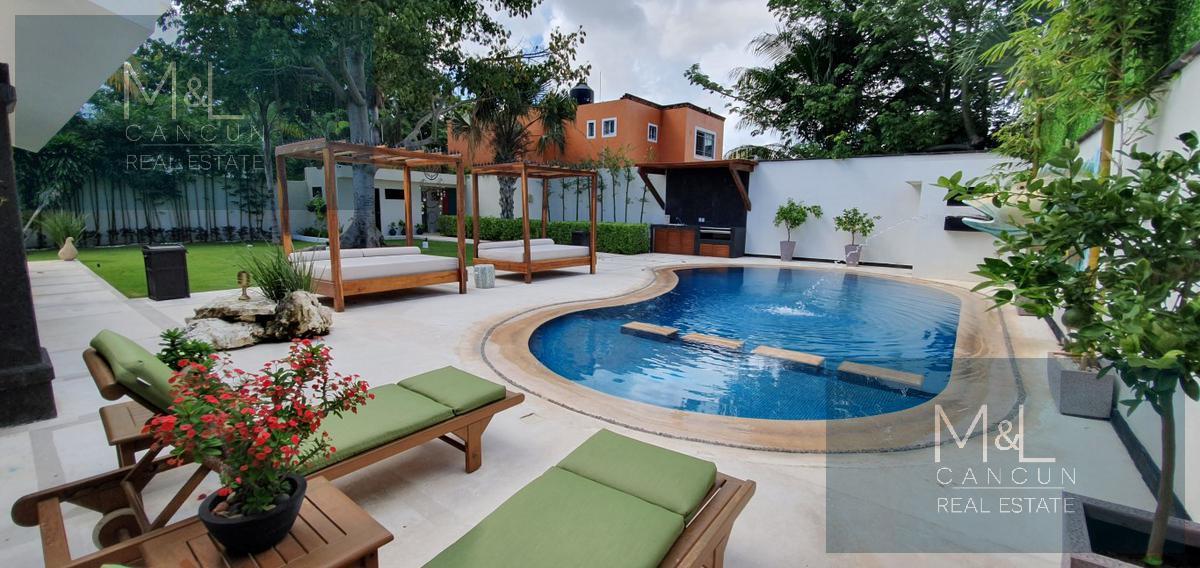 Foto Casa en Venta en  Alamos I,  Cancún  Casa en Venta Las Quintas, Alamos I. De lujo con 4 recámaras, gran jardín y alberca, Supermanzana 311 Cancún, Quintana Roo, México