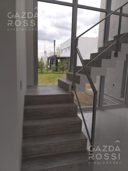 Foto Casa en Venta en  Los Naranjos,  Countries/B.Cerrado (E. Echeverría)  moderna propiedad de diseño en los naranjos