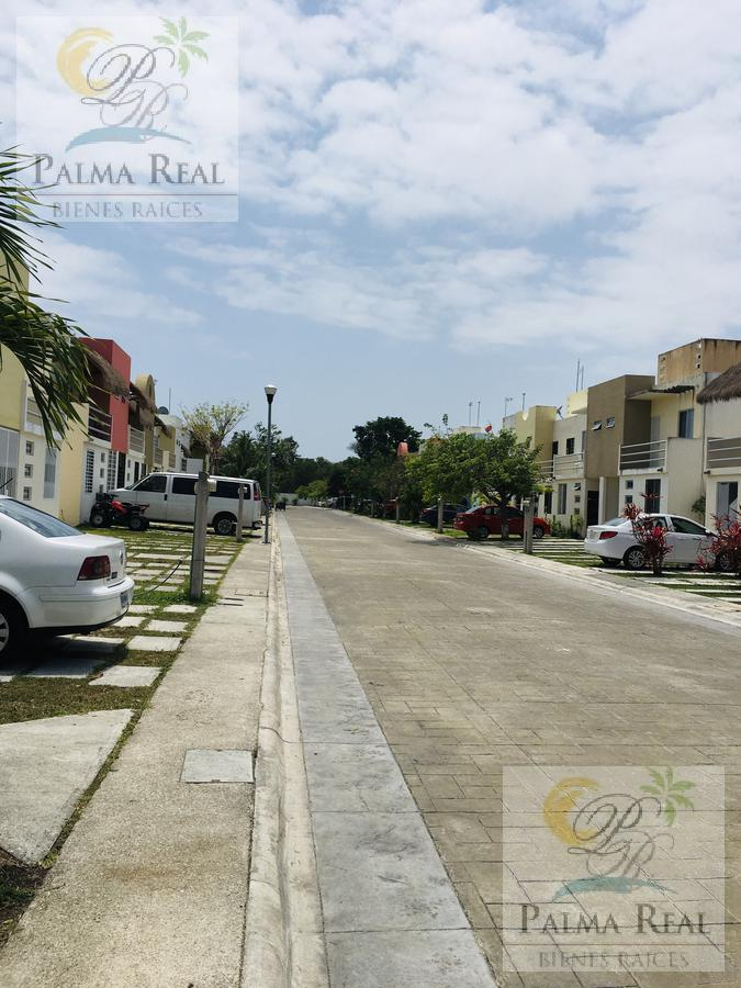 Foto Casa en Venta en  Quintana Roo ,  Quintana Roo  HERMOSA CASA EN RESIDENCIAL PALMA REAL-Puerto Morelos
