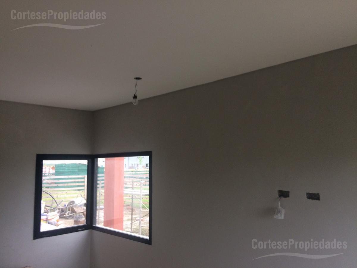 Foto Casa en Venta | Alquiler en  Ceibos,  Puertos del Lago  Barrio Ceibos
