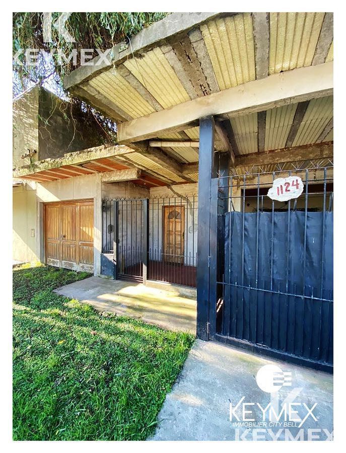 Foto Casa en Venta en  Los Hornos,  La Plata  Calle 148 e/ 54 y 55, Los Hornos - CASA + DEPTO EN VENTA