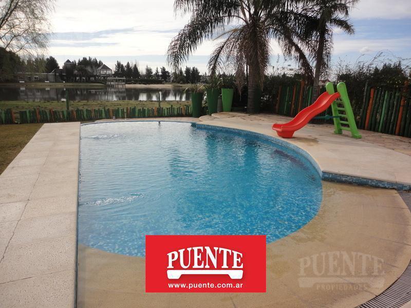 Foto Casa en Venta en  El Lauquen,  Countries/B.Cerrado (E. Echeverría)  El Lauquen I Excelente Casa Minimalista al Lago!