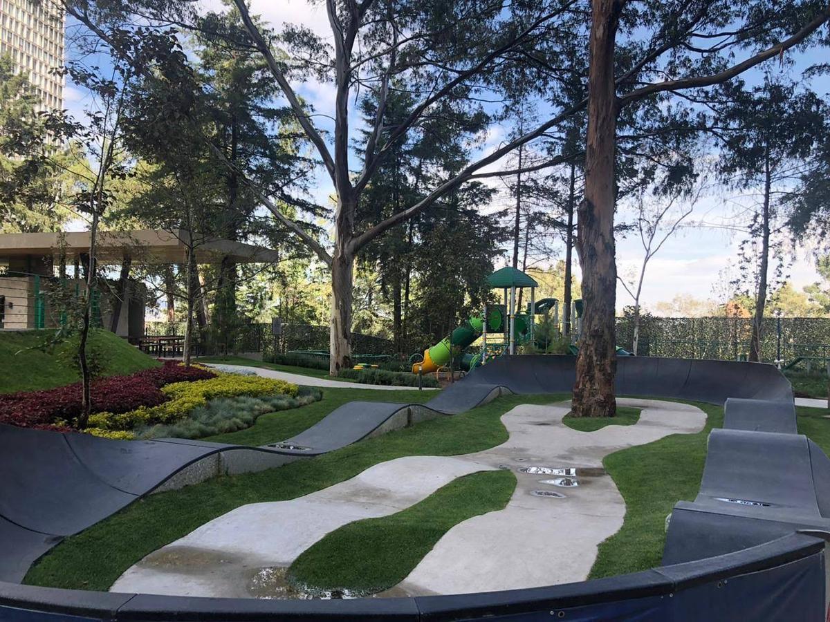 Foto Departamento en Venta en  Bosques de las Lomas,  Cuajimalpa de Morelos  Club Residencial Bosques departamento en venta con GRAN TERRAZA  Y JARDÍN (GR)